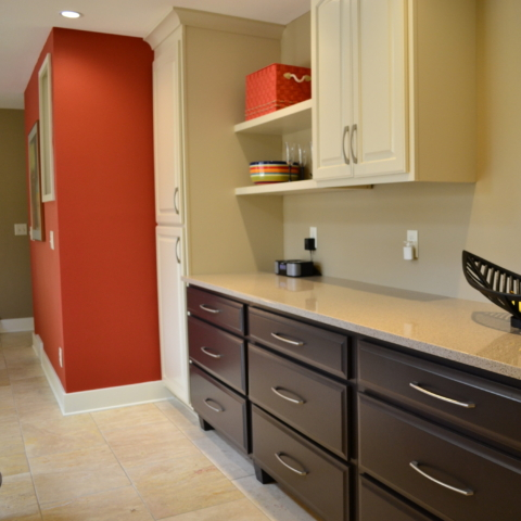 Deep brown and light tan cabinets with Red Wall