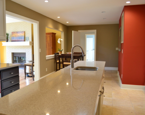 Sand-colored quartz counter top island in remodeled kitchen